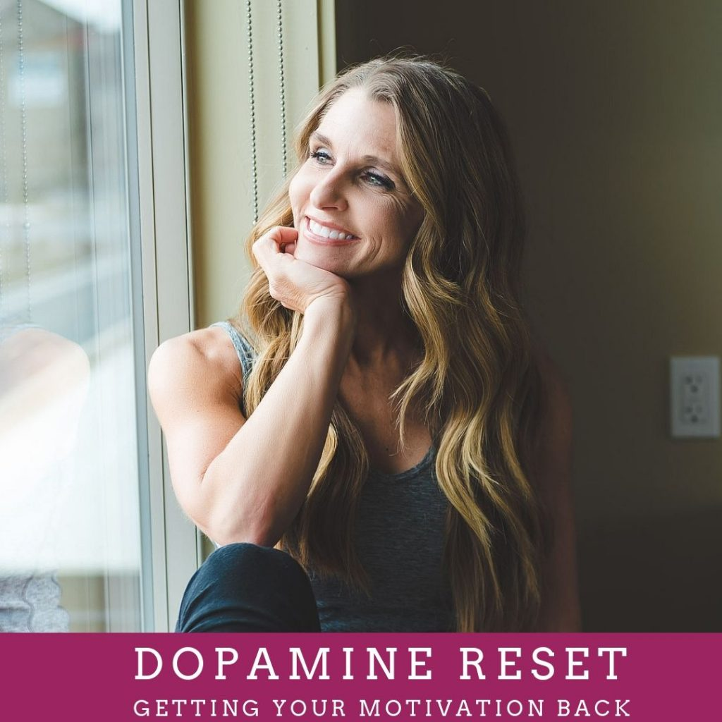 dopamine reset getting your motivation back girl sitting in a window