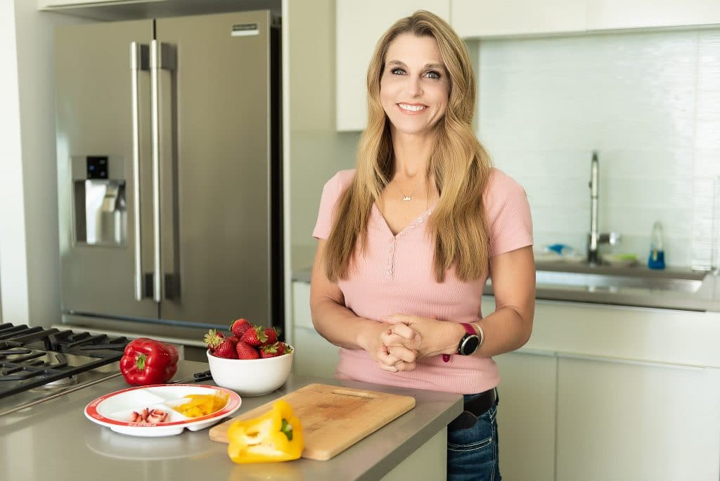 amy roskelley in the kitchen at health beet