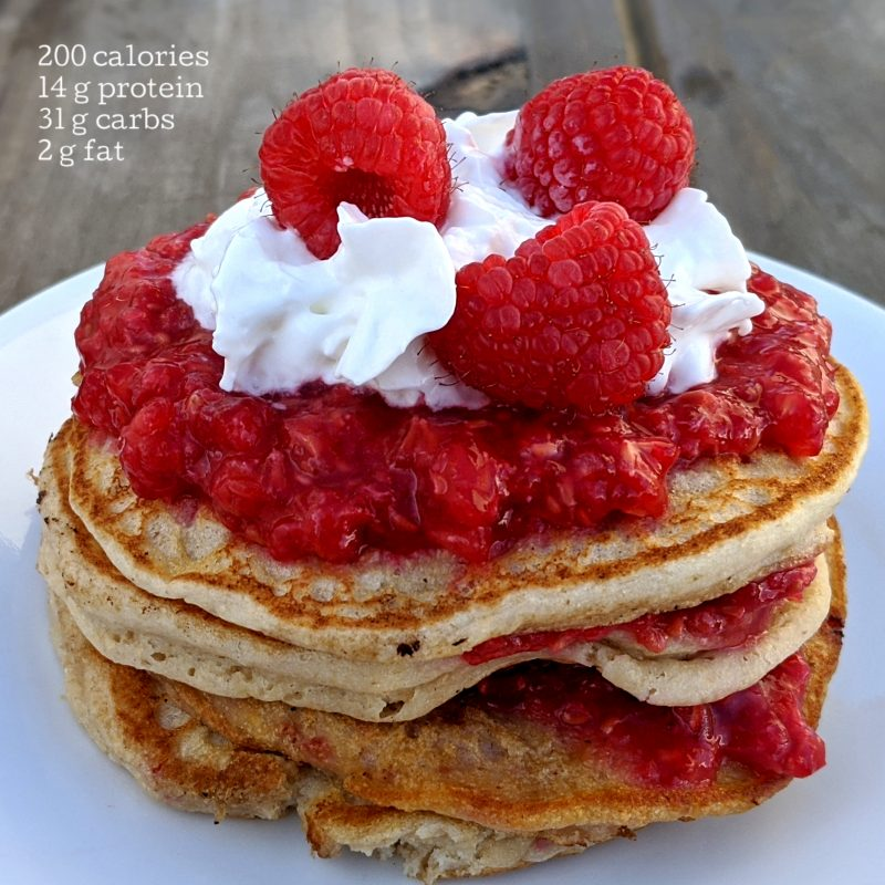 Pancakes with raspberries and whipped cream