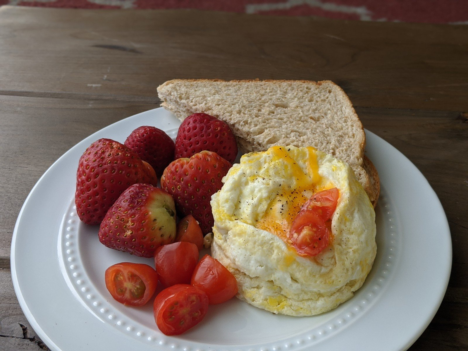 microwave eggs on plate with toast and berries