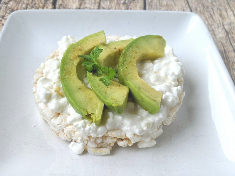cottage cheese and avocado on a rice cake