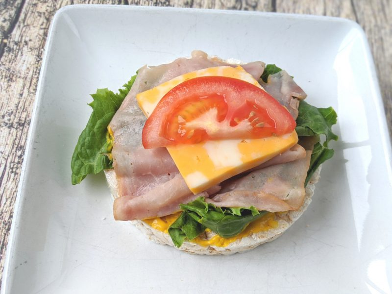 ham and cheese on a rice cake protein topping