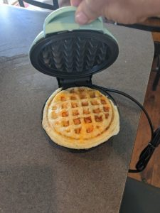 An egg and cheese on the dash mini waffle maker
