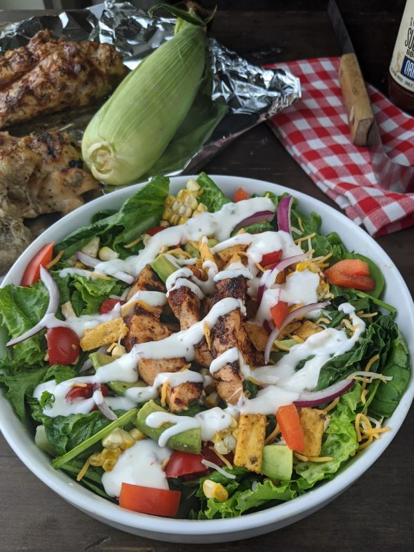 Grilled BBQ chicken salad with dressing