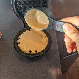 measuring batter for protein pumpkin waffle