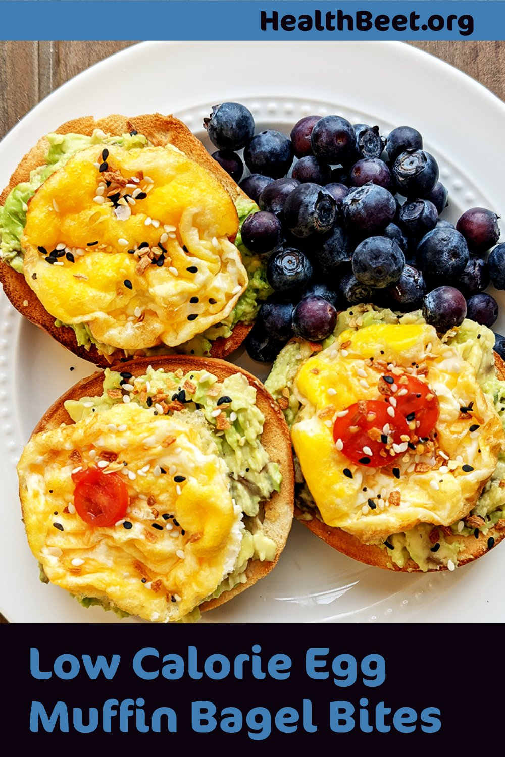 Egg white muffins on a mini bagel with avocado. Low calorie and delicious!