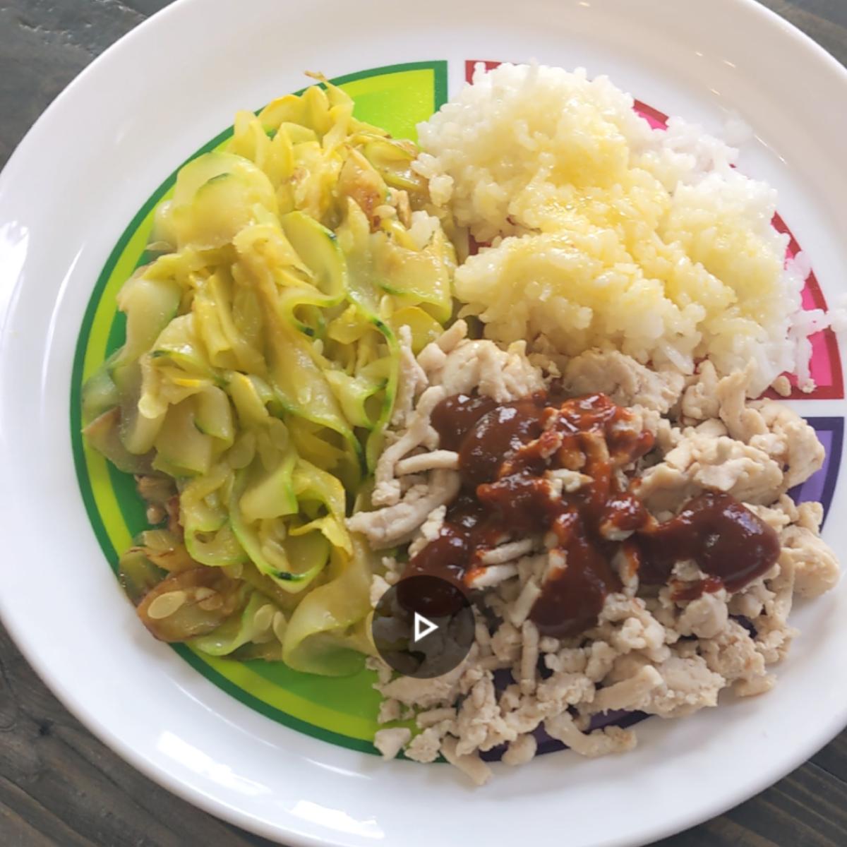 Dinner on macro plate  ground turkey rice and zucchini