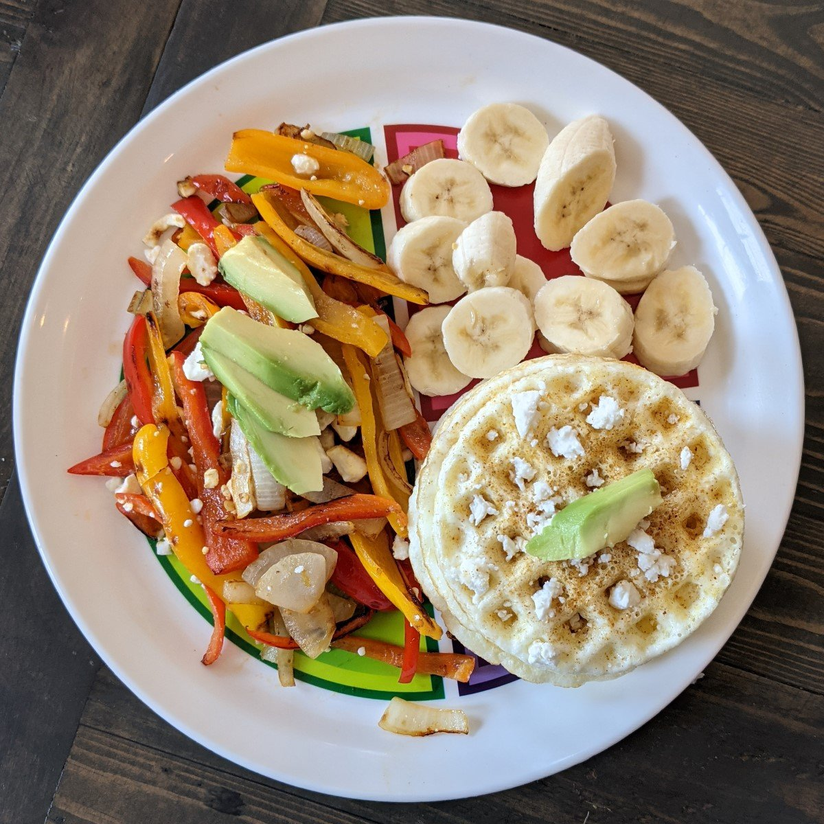 breakfast on macro plate eggs peppers and banana